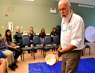 9/29/2018 Mike Orazzi | Staff Livingston Ripley Waterfowl Conservancy's Jay Fields shows off an ostrich egg during a presentation on birds at the Indian Rock Nature Center in Bristol Saturday morning.