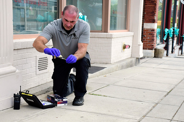 9/4/2018 Mike Orazzi | Staff Bristol Police Detective Scott Hayden tests for blood on red drops along Main Street. The trail stretches from Main at Summer on along Riverside Avenue for several blocks.