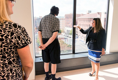 09/05/18  Wesley Bunnell | Staff  Mayor Erin Stewart looks out of the sixth floor window along with fellow board member Steven Andrychowski towards Central park during a tour of CMHA's new building at 233-235 Main St on Wednesday afternoon. The building will undergo renovations in preparation for CMHA's occupancy which was previously planned for 227 Main St.