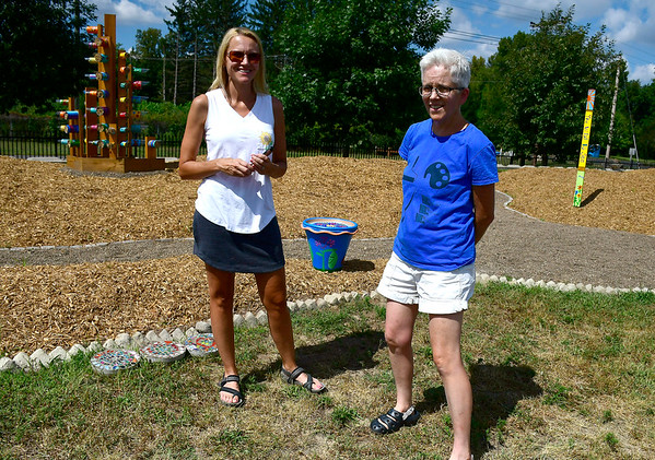 9/5/2018 Mike Orazzi | Staff Kim Rees and Clare Bean at a garden created with art from local 2nd to 5th graders along the Southington Rail to Trails behind the YMCA on Wednesday.