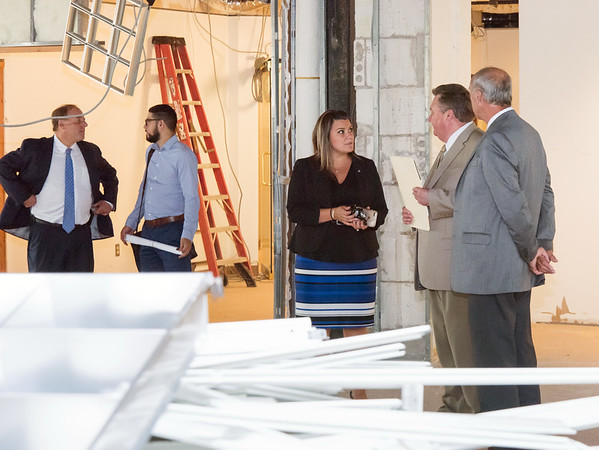 09/05/18 Wesley Bunnell | Staff Mayor Erin Stewart, middle, speaks with TBI Construction's Ken Johnson and Bill Wadsworth during CMHA's tour of their newest building located at 233 - 235 Main St in New Britain on Wednesday afternoon featuring planners and city officials. The building will undergo renovations in preparation for CMHA's occupancy which was previously planned for 227 Main St.
