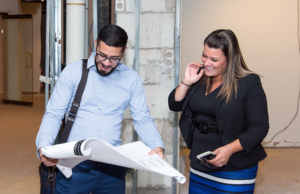 09/05/18 Wesley Bunnell | Staff Architect Arturo Arroyo from Svigals & Partners looks over blueprints with Mayor Erin Stewart detailing upcoming renovations to CMHA's newest building located at 233-235 Main St on Wednesday afternoon. The building will undergo renovations in preparation for CMHA's occupancy which was previously planned for 227 Main St.