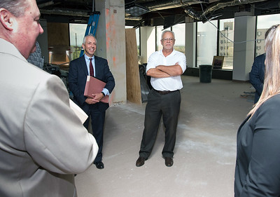 09/05/18  Wesley Bunnell | Staff  Tilcon CT's Leo Gagne, 2nd L, and Economic Development Director Bill Carroll, 3rd L, listen as Mayor Erin Stewart speaks during a tour of CMHA's newest building located at 233-235 Main St on Wednesday afternoon. The building will undergo renovations in preparation for CMHA's occupancy which was previously planned for 227 Main St.