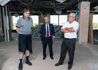 09/05/18  Wesley Bunnell | Staff  CMHA board members Steven Andrychowski, L, Tilcon CT's Leo Gagne and Economic Development Director Bill Carroll look over the renovations in progress during a tour of CMHA's newest building located at 233-235 Main St on Wednesday afternoon. The building will undergo renovations in preparation for CMHA's occupancy which was previously planned for 227 Main St.