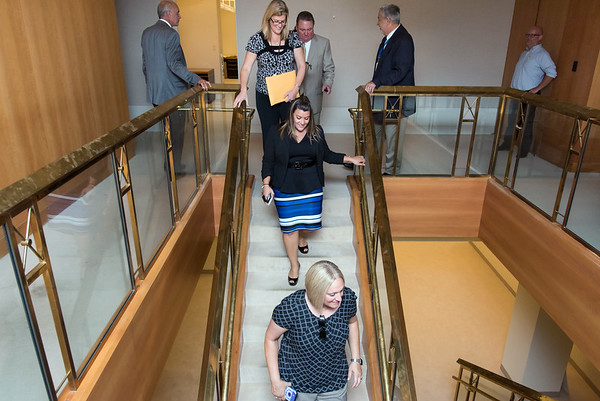 09/05/18 Wesley Bunnell | Staff Mayor Erin Stewart heads down the staircase from the 7th floor during CMHA's tour of their newest building located at 233 - 235 Main St in New Britain on Wednesday afternoon along with planners and other city officials. The building will undergo renovations in preparation for CMHA's occupancy which was previously planned for 227 Main St.