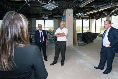 09/05/18  Wesley Bunnell | Staff  Tilcon CT's Leo Gagne, middle, and Economic Development Director Bill Carroll, 2nd left, listen as Mayor Erin Stewart speaks during a tour of CMHA's newest building located at 233-235 Main St on Wednesday afternoon. The building will undergo renovations in preparation for CMHA's occupancy which was previously planned for 227 Main St.