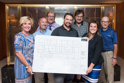 09/05/18  Wesley Bunnell | Staff  CMHA board members hold blueprints during a tour of their newest building located at 233 - 235 Main St in New Britain on Wednesday afternoon. The building will undergo renovations in preparation for CMHA's occupancy which was previously planned for 227 Main St. President and CEO of CMHA Raymond Gorman, back row L, Steven Andrychowski, Nick Pettinico, Ann Baldwin, front row L, Todd DeGroff, Hunter Mathena and Mayor Erin Stewart.