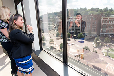 09/05/18  Wesley Bunnell | Staff  Mayor Erin Stewart looks out of the sixth floor window towards Central park during a tour of CMHA's new building at 233-235 Main St on Wednesday afternoon. The building will undergo renovations in preparation for CMHA's occupancy which was previously planned for 227 Main St.