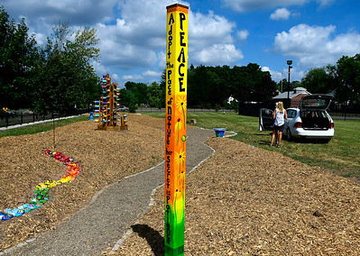 9/5/2018 Mike Orazzi | Staff A garden created with art from local 2nd to 5th graders along the Southington Rail to Trails behind the YMCA on Wednesday.