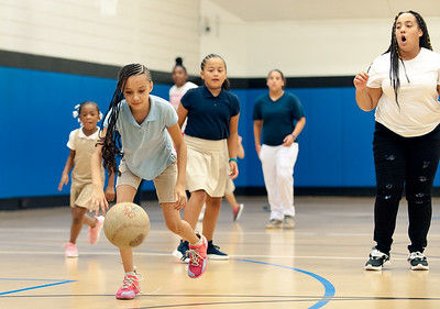09/06/18  Wesley Bunnell | Staff  Ariana Pelletier fields the ball during a game of kickball at the Boys & Girls Club of New Britain on Thursday afternoon. The club's after school programs have opened earlier than normal to accommodate school children during the CSDNB's decision to start the school year off on half days due to excessive heat.