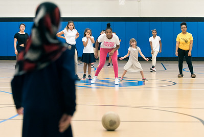 09/06/18  Wesley Bunnell | Staff  Nikira Hooks, center, pitches the ball during a game of kickball at The Boys & Girls Club of New Britain on Thursday afternoon. The club's after school programs have opened earlier than normal to accommodate children during the CSDNB's decision to start the school year off on half days due to excessive heat.