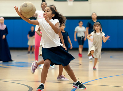 09/06/18  Wesley Bunnell | Staff  Kiara Santiago fields the ball during a game of kickball at the Boys & Girls Club of New Britain on Thursday afternoon. The club's after school programs have opened earlier than normal to accommodate school children during the CSDNB's decision to start the school year off on half days due to excessive heat.