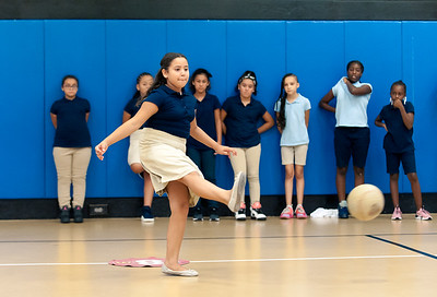 09/06/18  Wesley Bunnell | Staff  It's Hailey Rivera's turn during a game of kickball at the Boys & Girls Club of New Britain on Thursday afternoon as fellow team members watch. The club's after school programs have opened earlier than normal to accommodate school children during the CSDNB's decision to start the school year off on half days due to excessive heat.