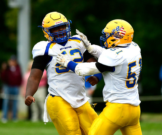9/8/2018 Mike Orazzi | Staff Seymour's Markel McNight (52) and Not on Roster (51) in Bristol Saturday.