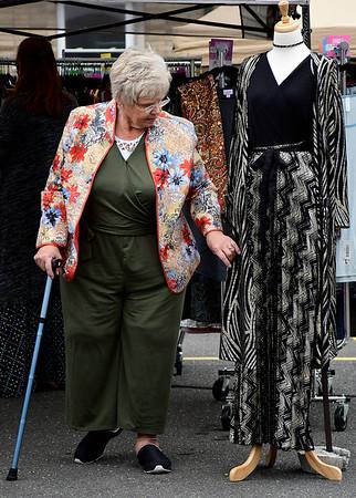 9/8/2018 Mike Orazzi | Staff Judi Pavan shops clothing during Dozynki at St. Stanislaus Church in Bristol Saturday.