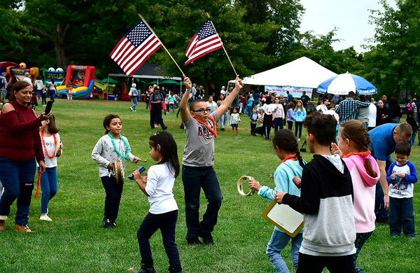 9/8/2018 Mike Orazzi | Staff Yandel Duran, 10, waves American flags while leading a parade in the Kids Zone during Main Street USA held in New Britain's Walnut Hill Park Saturday.