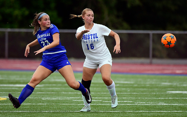 9/11/2018 Mike Orazzi | Staff Plainville's Krystyna Miller (23) and Bristol Eastern's Meredith Forman (16) during Tuesday's soccer at Plainville High School.