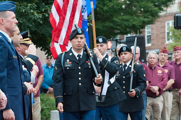 09/11/18 Wesley Bunnell | Staff New Britain unveiled its newest monument in Central Park which is dedicated to the War on Terror following the 9/11 attacks. The Retiring of the Colors by the CT Air National Guard with PFC David Geuser, shown front.
