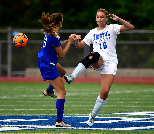 9/11/2018 Mike Orazzi | Staff Plainville's Olympia Bielawski (16) and Bristol Eastern's Meredith Forman (16) during Tuesday's soccer at Plainville High School.