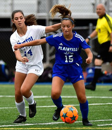 9/11/2018 Mike Orazzi | Staff Bristol Eastern's Kailey Laprise (14) and Plainville's Delaney Beausoleil (15) during Tuesday's soccer at Plainville High School.