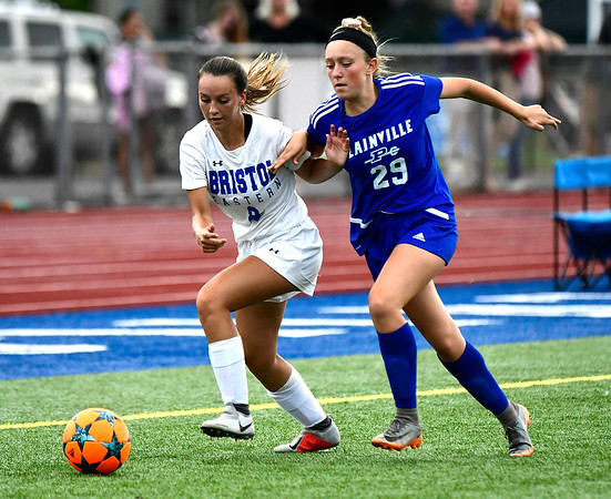 9/11/2018 Mike Orazzi | Staff Bristol Eastern's Sara Stadnicki (8) and Plainville's Lyndsey DiTolla (29) during Tuesday's soccer at Plainville High School.