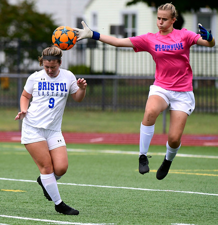 9/11/2018 Mike Orazzi | Staff Bristol Eastern's Myah Croze (9) and Plainville's Caitlyn Barker (30) during Tuesday's soccer at PHS.