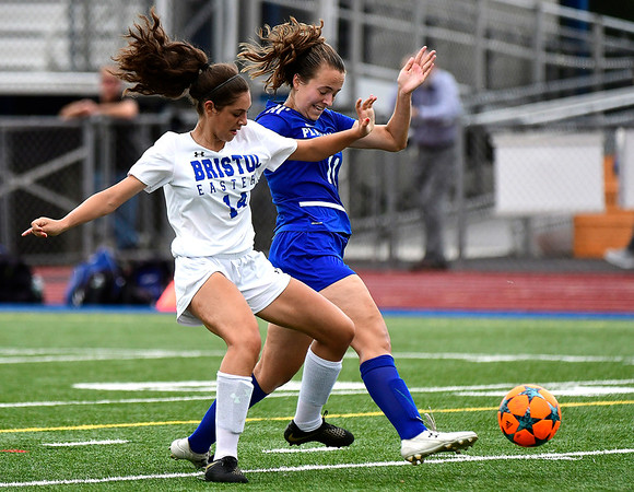 9/11/2018 Mike Orazzi | Staff Bristol Eastern's Kailey Laprise (14) and Plainville's Rachel Parsons (11) during Tuesday's soccer at Plainville High School.