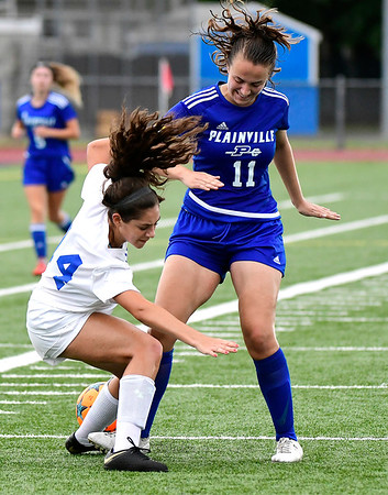 9/11/2018 Mike Orazzi | Staff Bristol Eastern's Kailey Laprise (14) and Plainville's Ciara Collins (11) during Tuesday's soccer at Plainville High School.