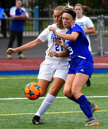 9/11/2018 Mike Orazzi | Staff Plainville's Lyndsey DiTolla (29) and Bristol Eastern's Annabella Lusitani (21) during Tuesday's soccer at Plainville High School.