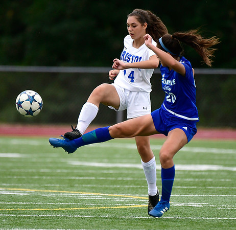 9/11/2018 Mike Orazzi | Staff Bristol Eastern's Kailey Laprise (14) and Plainville's Ebelyn Rodriguez (20) during Tuesday's soccer at Plainville High School.
