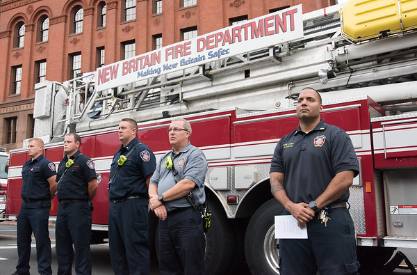 09/11/18 Wesley Bunnell | Staff New Britain unveiled its newest monument in Central Park which is dedicated to the War on Terror following the 9/11 attacks. Members of the New Britain Fire Department stand in a closed off West Main St in front of City Hall including Fire Chief Raul Ortiz, R.