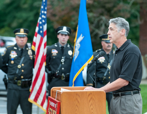 09/11/18 Wesley Bunnell | Staff Berlin officially dedicated its 9/11 Memorial in front of the Kensington Fire Department on Tuesday afternoon featuring steel beams from the World Trade Center. Mayor Mark Kaczynski addresses the crowd.