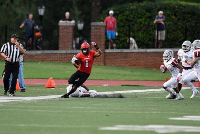 William Wicks keeps his footing as the Guilford defender whiped out trying to tackle him. Wicks, a junior from Fayetteville, scored 3 TDs in the 'Cats' 91-61 win over Guilford.