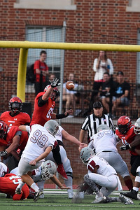 """Corey Coppola, a 6'3"""" defensive tackle, batted away the extra point attempt in the first quarter. It was one of three blocked kicks for the 'Cats in the record-setting 91-61 win over Guildford."""