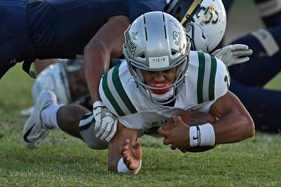 De La Salle quarterback Dorian Hale (10) runs with the ball against Centra Catholic in the second quarter of their game at Central Catholic High School in Modesto, Calif. on Friday, Aug. 30, 2019. (Jose Carlos Fajardo/Bay Area News Group)