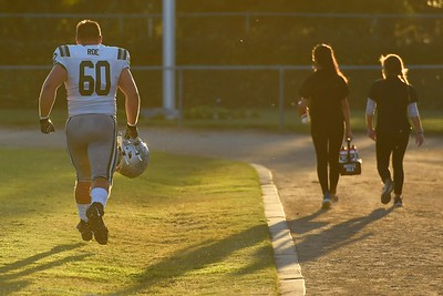 De La Salle's Ben Roe (60) runs back to the team huddle before playing Centra Catholic during their game at Central Catholic High School in Modesto, Calif. on Friday, Aug. 30, 2019. (Jose Carlos Fajardo/Bay Area News Group)