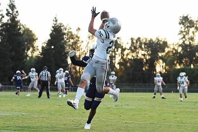 De La Salle's Grant Daley (26) battles Centra Catholic's Frank Clark (9) for a pass in the first quarter of their game at Central Catholic High School in Modesto, Calif. on Friday, Aug. 30, 2019. (Jose Carlos Fajardo/Bay Area News Group)