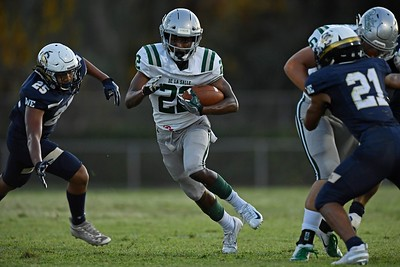 De La Salle's James Coby (22) runs for yardage against Centra Catholic in the first quarter of their game at Central Catholic High School in Modesto, Calif. on Friday, Aug. 30, 2019. (Jose Carlos Fajardo/Bay Area News Group)
