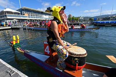 Drummer Celia Liang, of San Francisco, directs her team from Wells Fargo as they board their boat before competing during the 24th Annual Northern California International Dragon Boat Festival at Lake Merritt in Oakland, Calif., on Saturday, Sept. 28, 2019. The event is presented by the California Dragon Boat Association. Hundreds of participants from around the country compete in 95 races while paddling in 40-foot dragon boats during the two day event. (Jose Carlos Fajardo/Bay Area News Group)