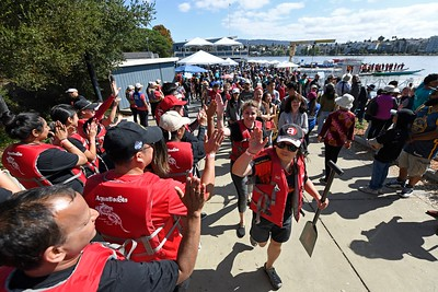 Participants congratulate each other after competing during the 24th Annual Northern California International Dragon Boat Festival at Lake Merritt in Oakland, Calif., on Saturday, Sept. 28, 2019. The event is presented by the California Dragon Boat Association. Hundreds of participants from around the country compete in 95 races while paddling in 40-foot dragon boats during the two day event. (Jose Carlos Fajardo/Bay Area News Group)