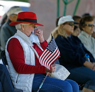 Rose Marie Weil holds a handkerchief to her face during a Memorial Day observance at Oakmont Memorial Park & Mortuary in Lafayette, California on Monday, May 27, 2019. (Dylan Bouscher/Bay Area News Group)