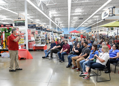 Ace Hardware District Manager Tim Wilson, left, speaks during a staff meeting at the new East Avenue location Tuesday in Chico. (Matt Bates -- Enterprise-Record)