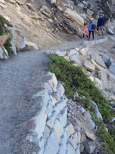A family moves Saturday down the newly renovated Bumpass Hell trail in Lassen Volcanic National Park. The new trail features some substantial retaining walls like those shown here, and a new gravel surface. (Steve Schoonover -- Enterprise-Record)