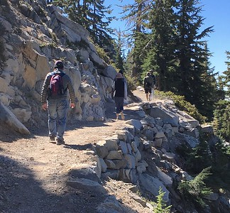 Hikers move Saturday up the trail to Bumpass Hell in Lassen Volcanic National park, past the new retaining walls that have allowed construction of a wider, more regular surface. (Steve Schoonover -- Enterprise-Record)