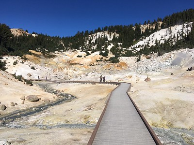 Visitors move Saturday down the new boardwalk in Bumpass Hell at Lassen Volcanic National Park. The boardwalk is constructed of plastic lumber, better able to withstand the acidic conditions in the geothermal basin. (Steve Schoonover -- Enterprise-Record)