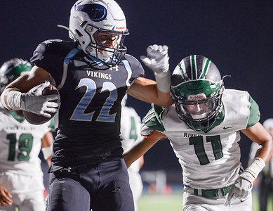 Pleasant Valley's Aidan Parks sheds a defender on his way to end zone for a second quarter touchdown during the Viking's game against River Valley on Sept. 13 in Chico. (Matt Bates -- Enterprise-Record)