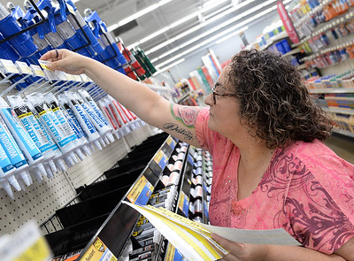 Diana Valle helps with set up on the new Chico Ace Hardware location by placing price tags on items Tuesday in Chico. (Matt Bates -- Enterprise-Record)