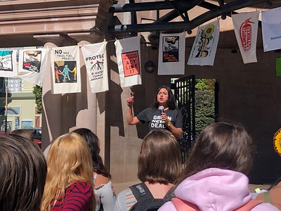 Ali Meders-Knight helps leads the Climate Strike organized by Sunrise Movement in the downtown plaza in Chico on Friday. (Natalie Hanson --Enterprise-Record)