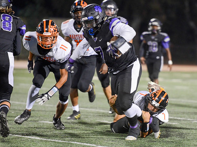 Oroville's Kacie Riley attempts to shed a defender during the Tigers' game against Marysville on Sept. 6 in Oroville. (Matt Bates -- Enterprise-Record)