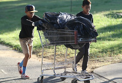 Jeovany Navarrete, 12, and his brother Johny,12, volunteered for Feather River Clean Up day Saturday in Oroville. (Mathew Miranda -- ENterprise-Record)